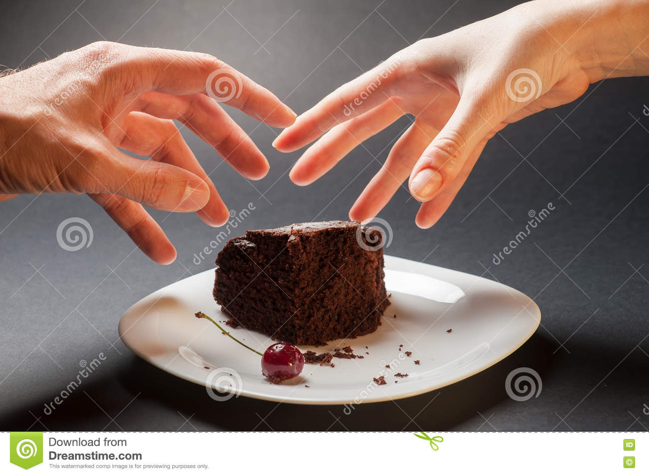 Concept with hands and chocolate cake