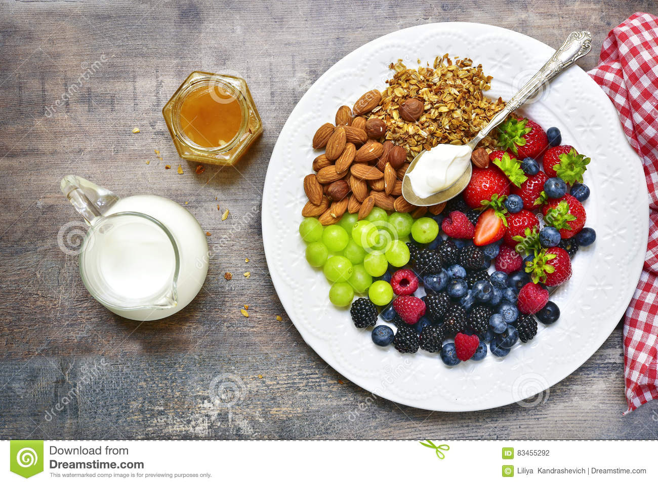 Concept of healthy breakfast : granola, nuts, fresh berries and yo