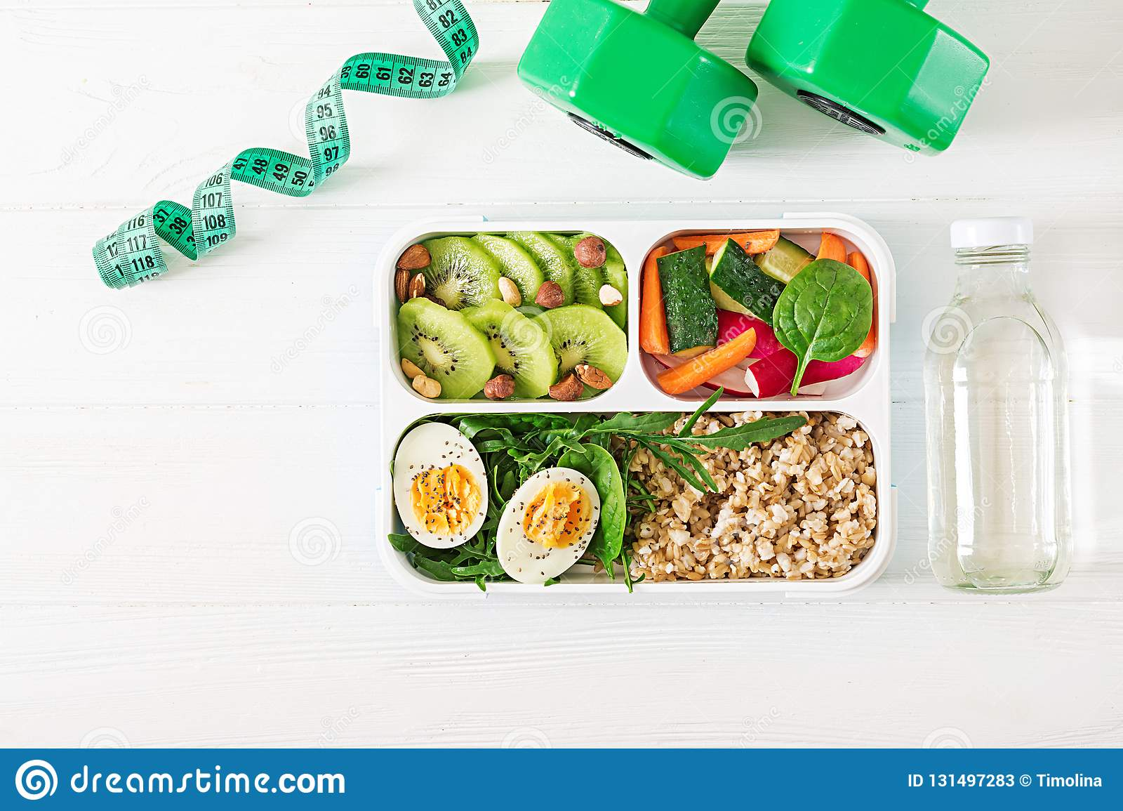 Concept healthy food and sports lifestyle. Vegetarian lunch. Healthy breakfast. Proper nutrition. Lunchbox. Top view. Flat lay