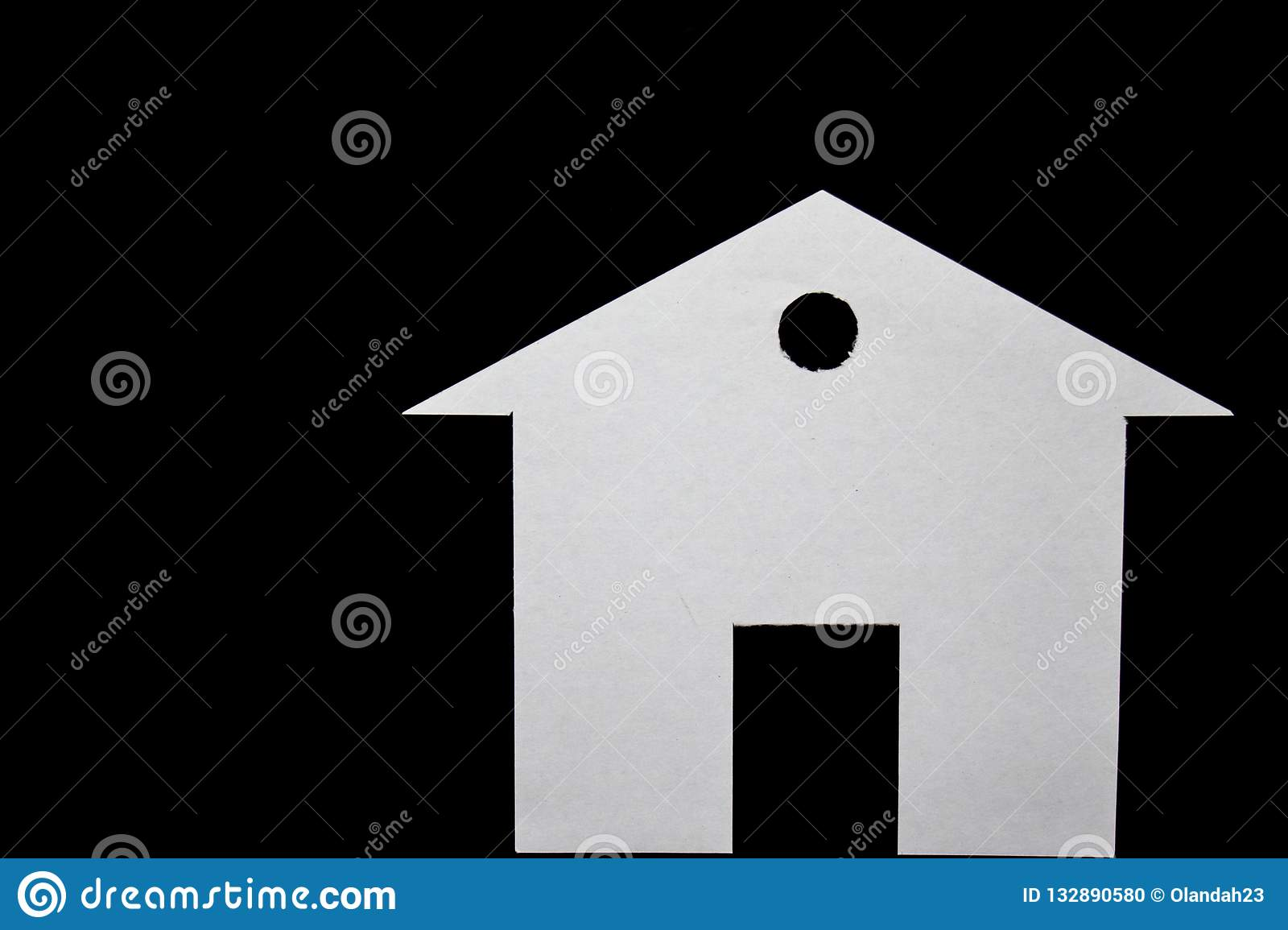Concept of house in paper on black background. Horizontal composition. Top view.