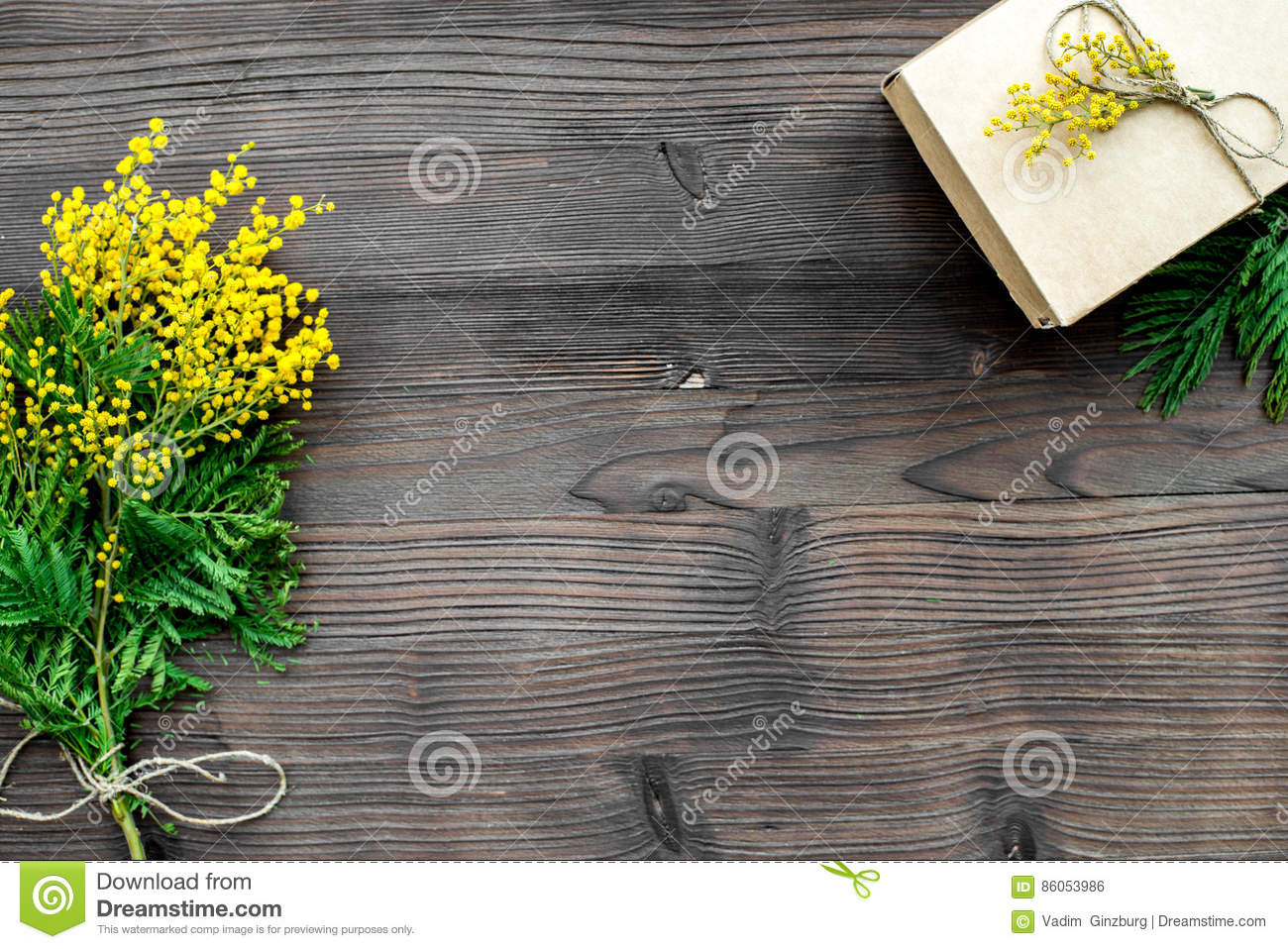Concept International Women Day with flowers wooden background top view