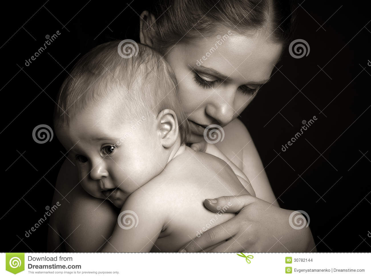 Concept for love and family. mother hugging baby tenderly in mon
