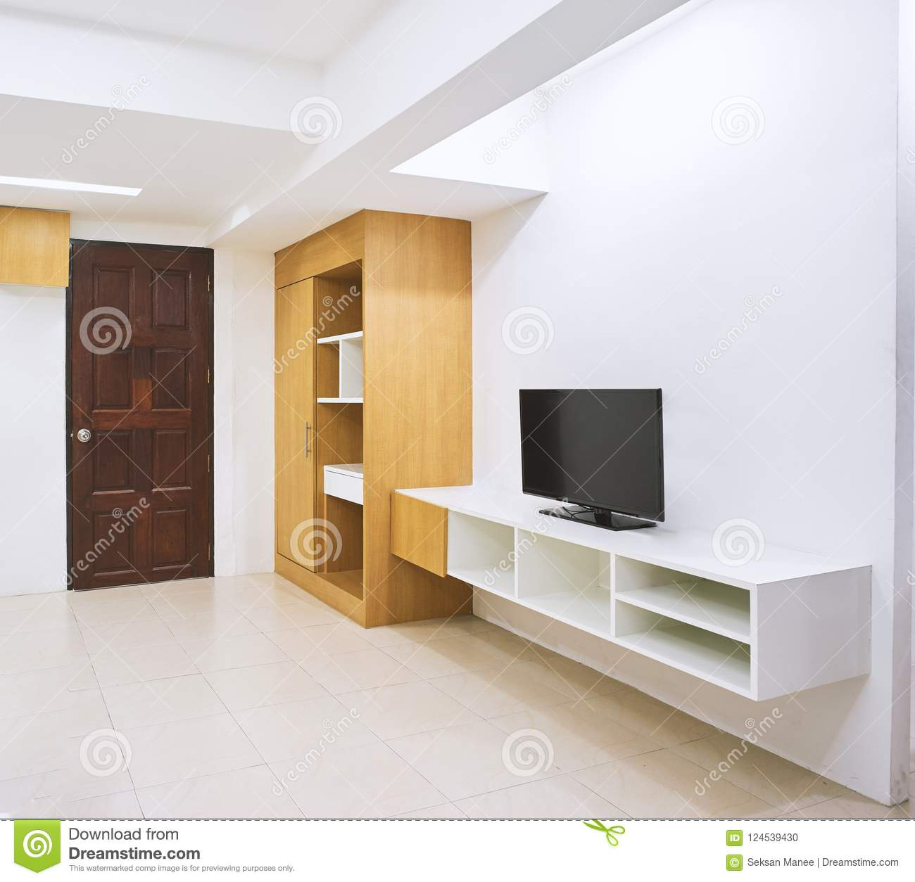 Concept of modern living apartment room decoration with built in furniture with tv and closet mock up in the white room