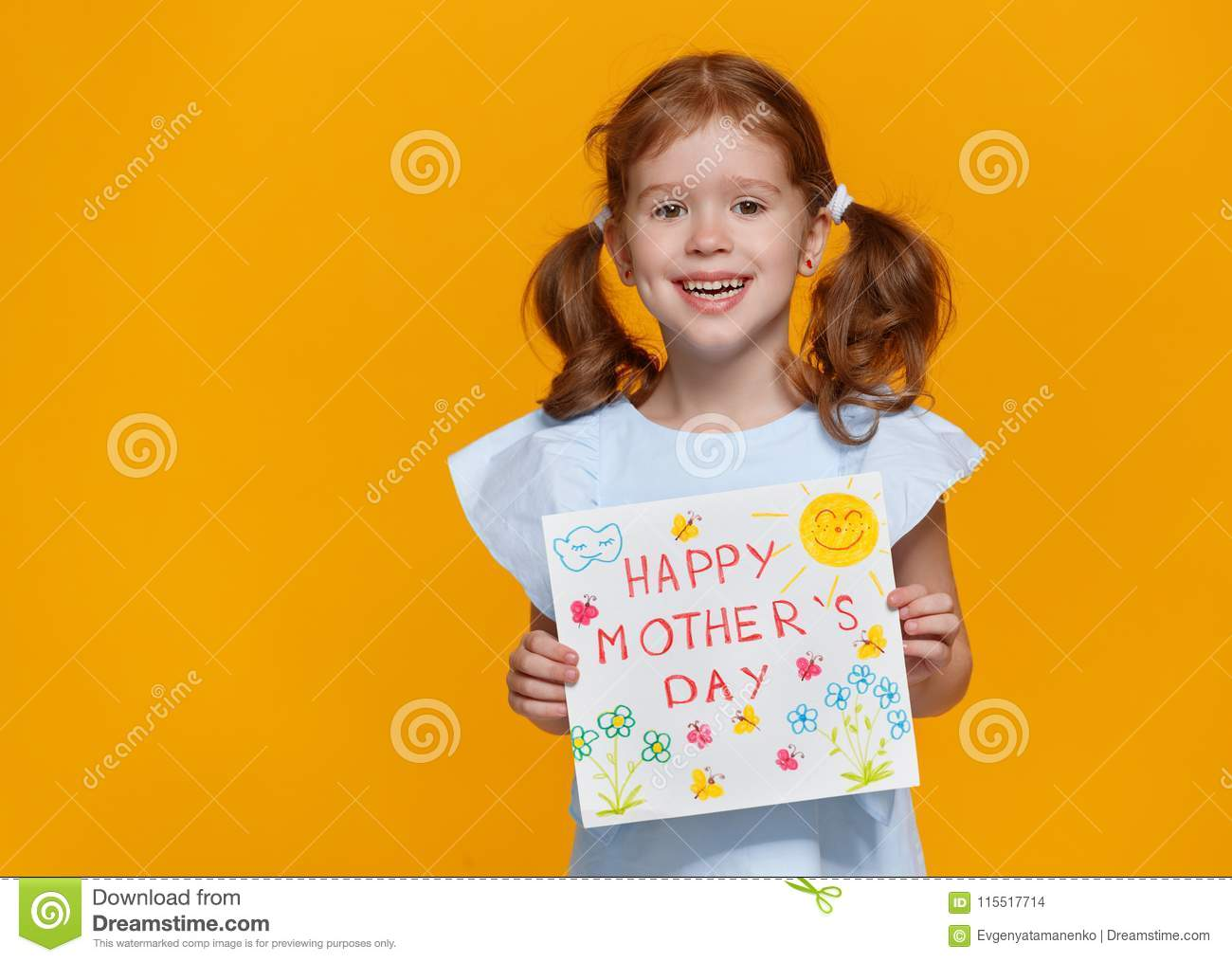 Concept of mother`s day. cheerful laughing child girl with postc