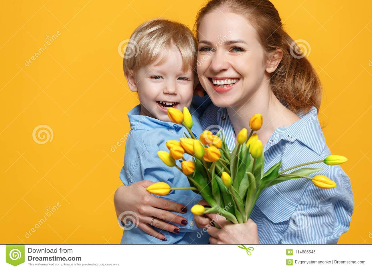Concept Of Mothers Day Mom And Baby Son With Flower On Colored
