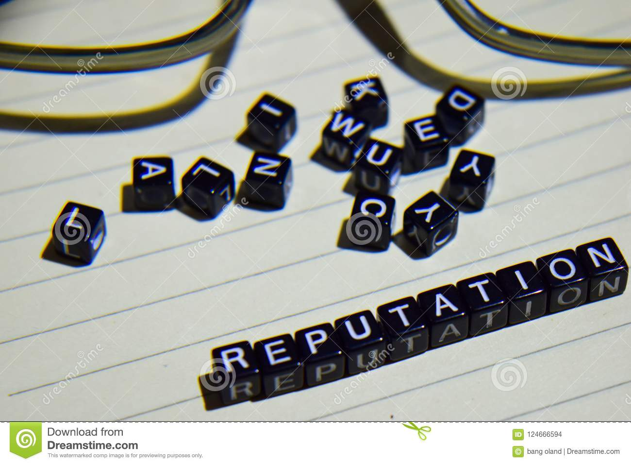 Concept of Reputation on wooden cubes with glass eye, books in Vintage background