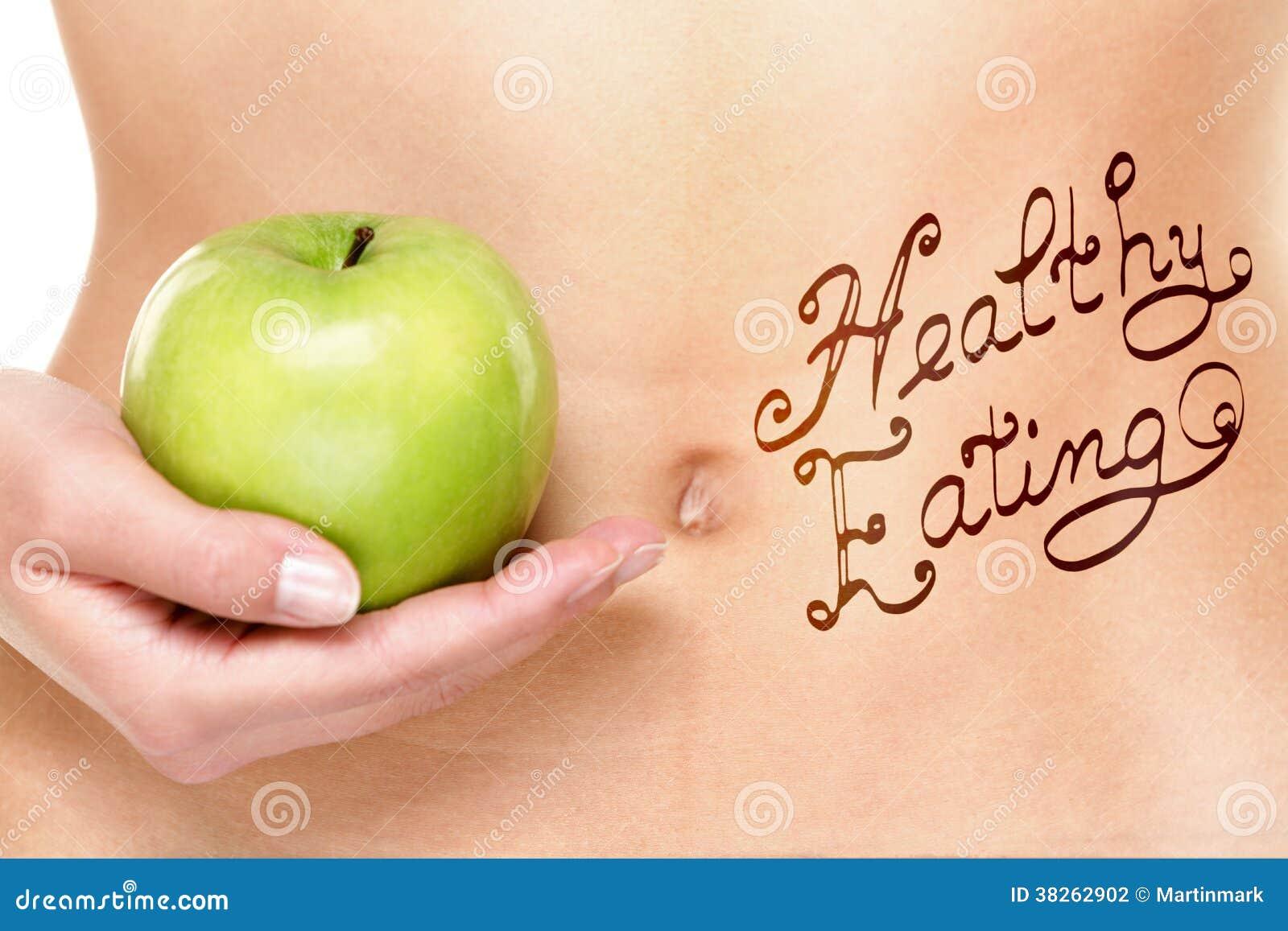Concept sain de consommation - estomac et pomme de femme