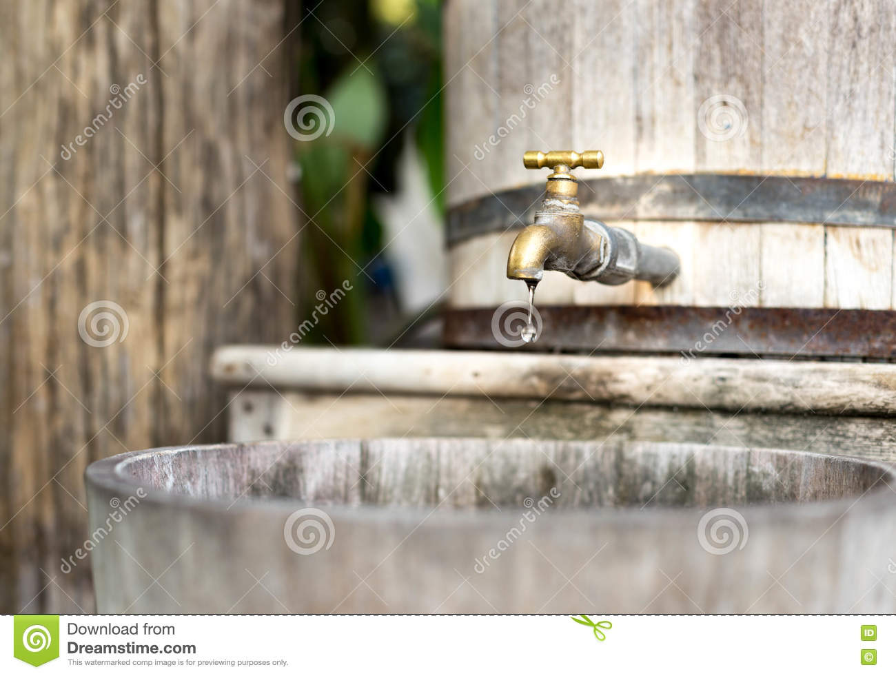 Concept saving water wooden water tank with golden tap and in s