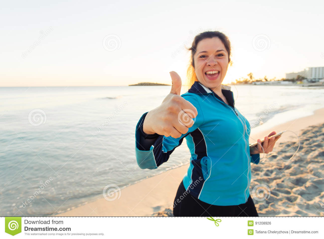 Concept of sport, fitness, healthy lifestyle and running - Motivated sporty woman doing thumbs up success gesture after
