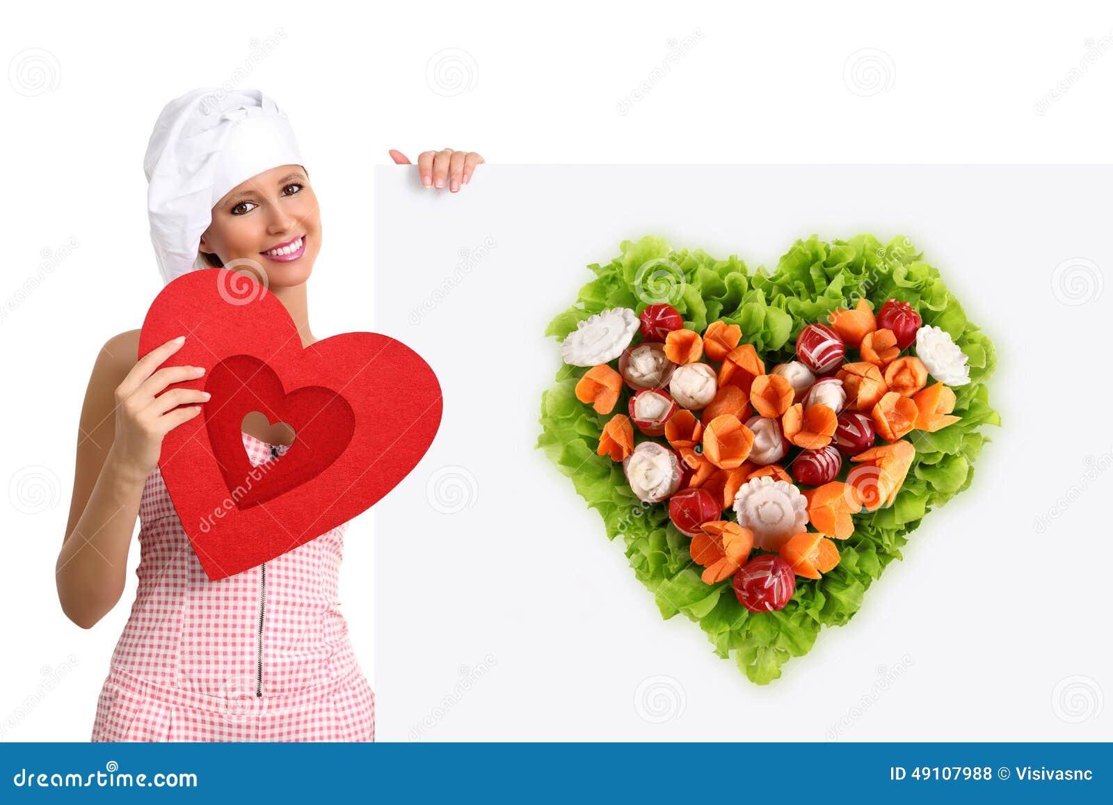 Concept vegetarian diet chef woman pointing billboard salad heart shape