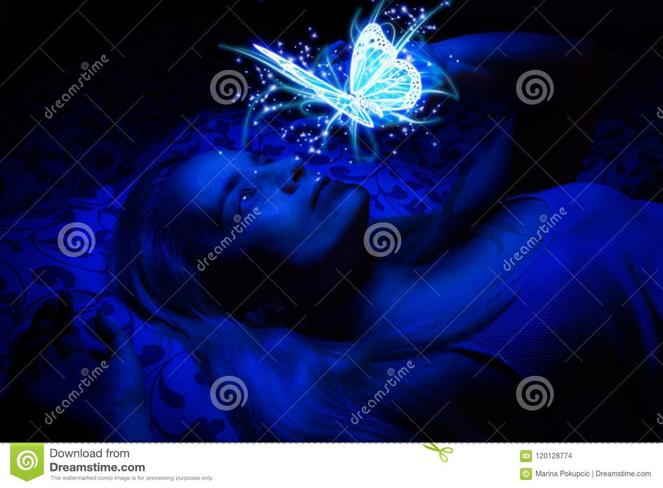 Download Concept Of A Woman Laying In Bed In The Dark, Illuminated With Blue Light From Floating Magical Butterfly Stock Photo - Image of enjoyment, magical: 120128774