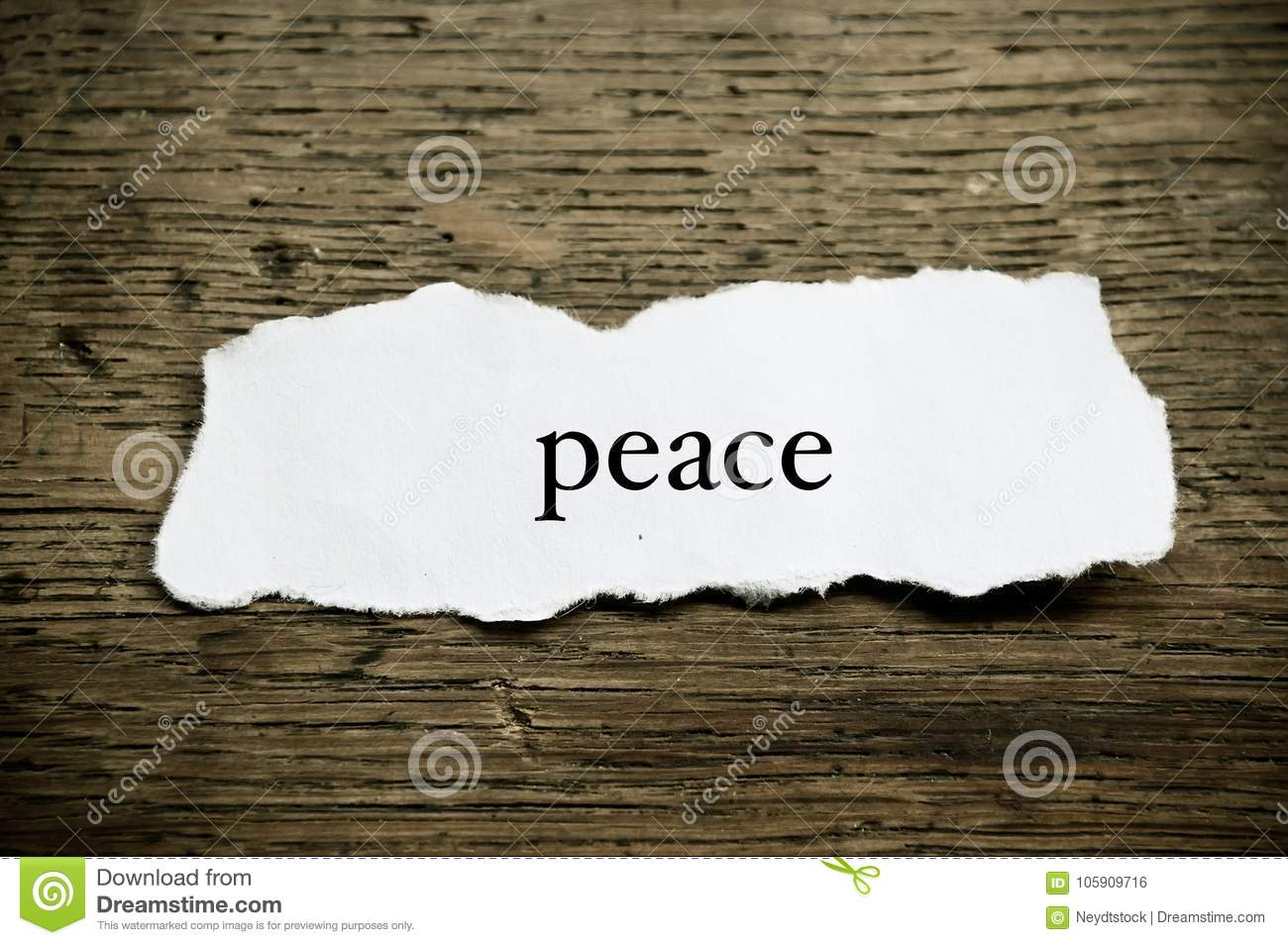 Concept word on paper on wooden desk - Peace