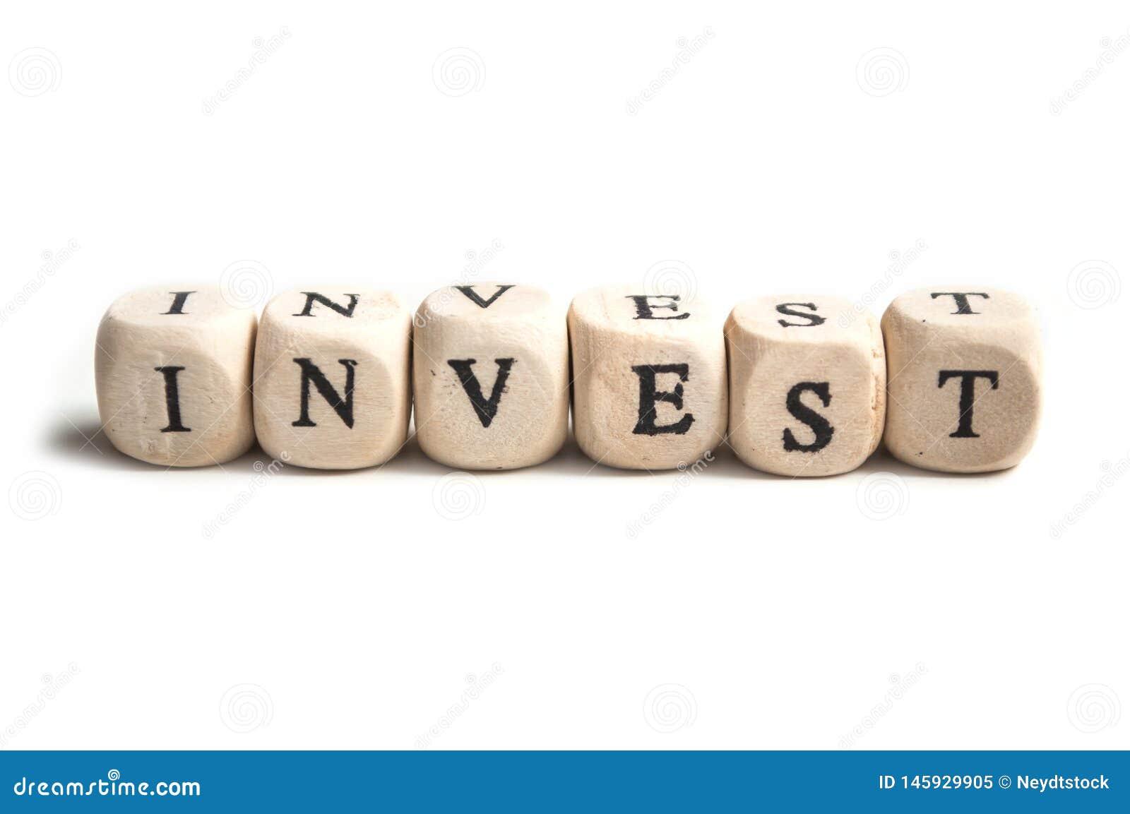 Conceptenwoord op houten kubus - investeer