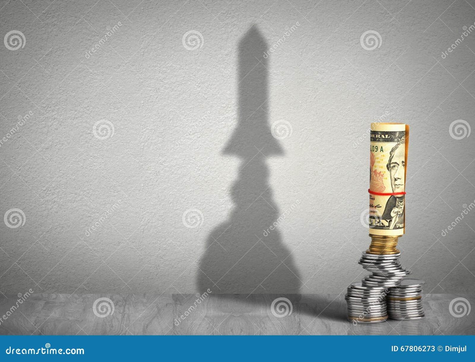 Concepto creativo del crecimiento financiero, dinero con la sombra del cohete