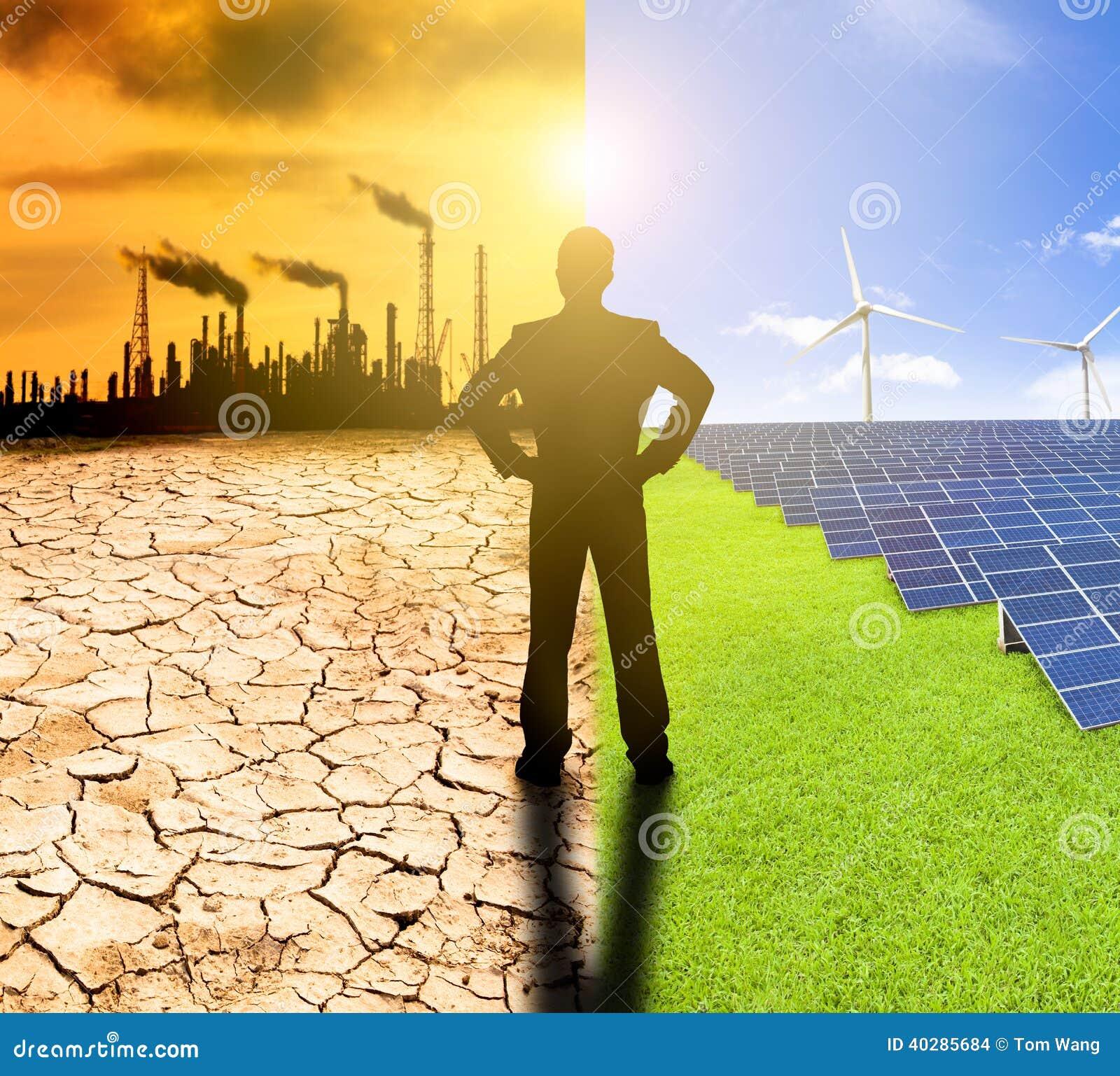 Concepto de la contaminación y de la energía limpia. windmil de observación del hombre de negocios