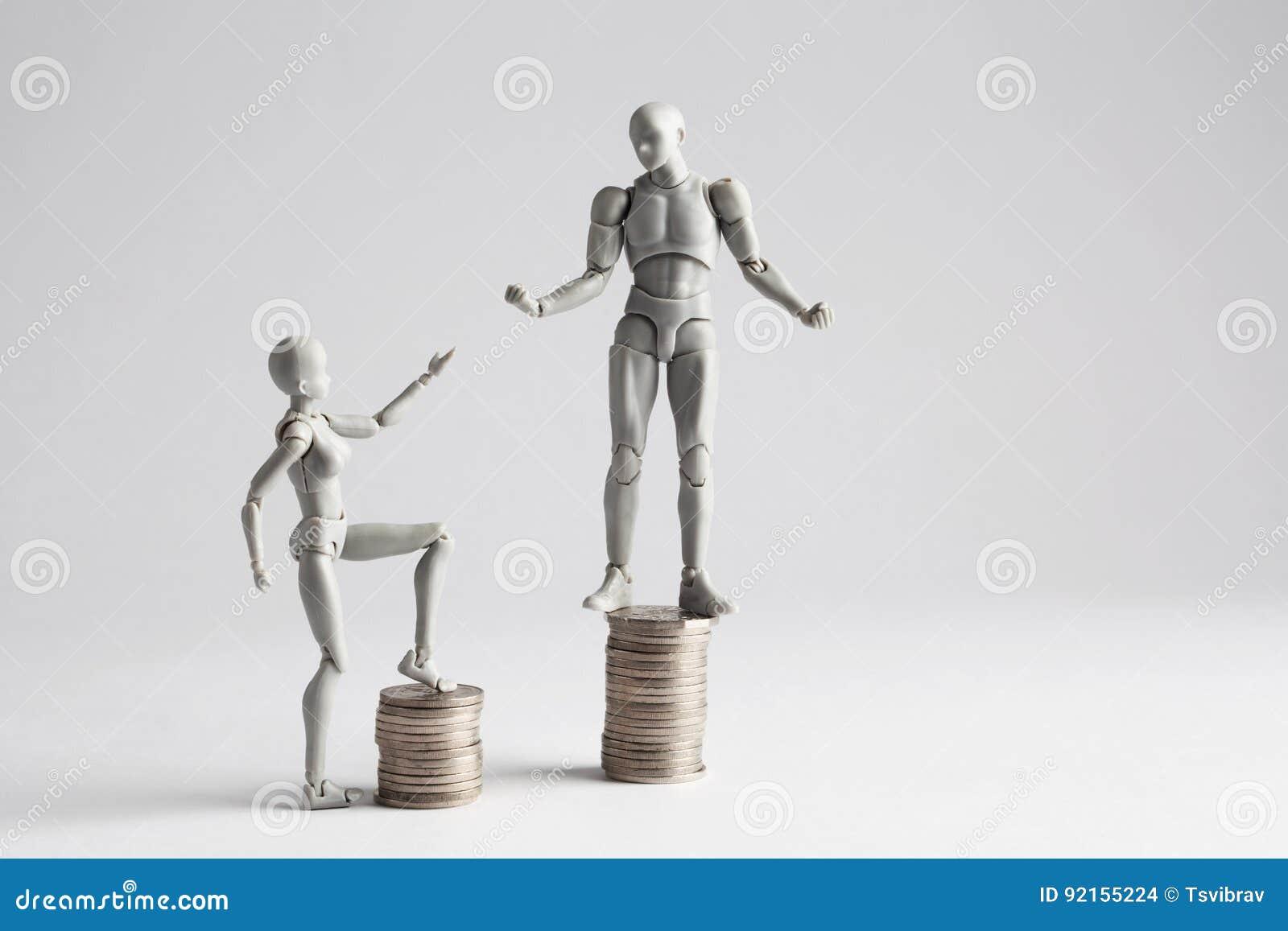 Concepto de la desigualdad de la renta mostrado con las estatuillas