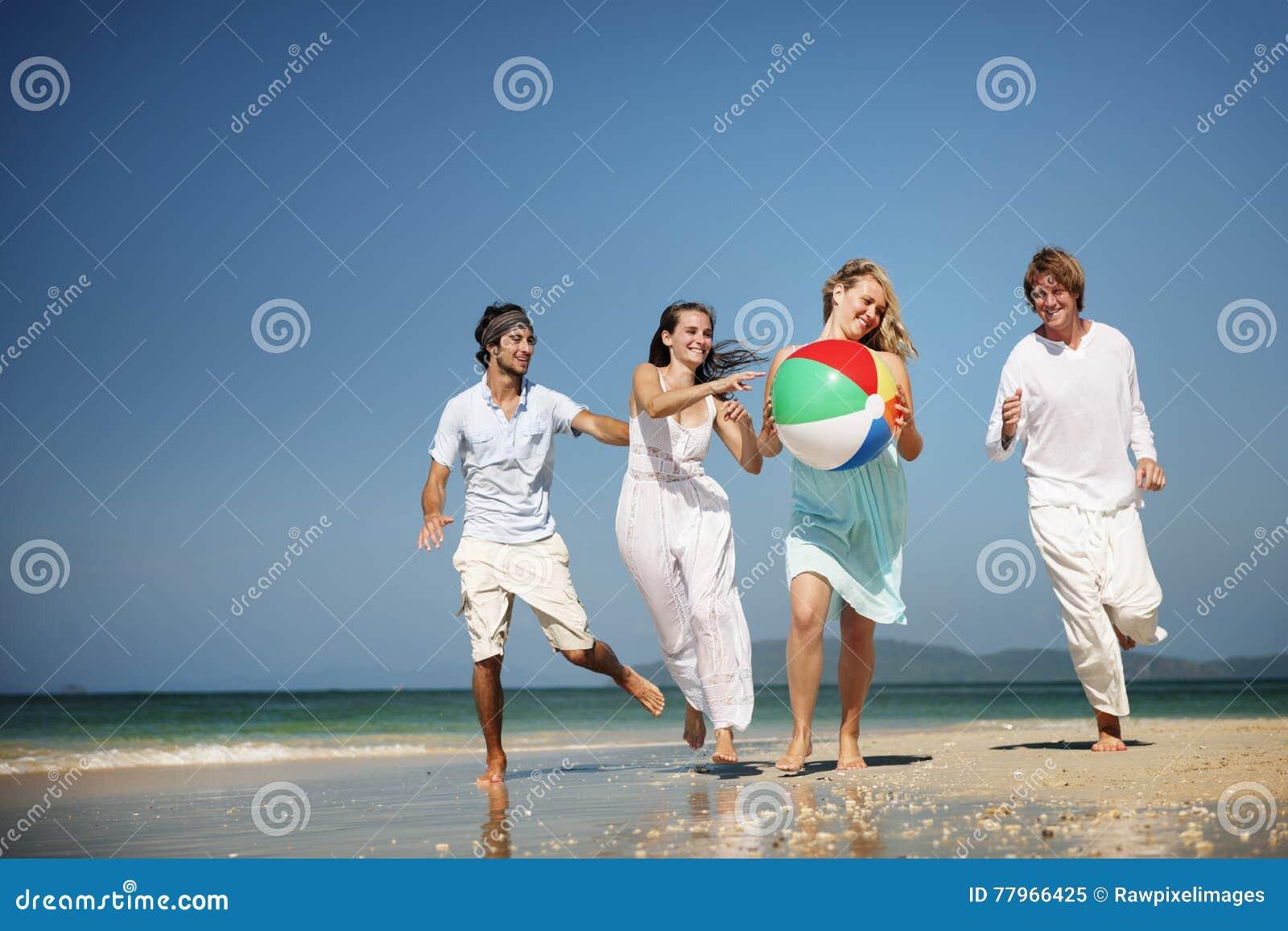 Concepto de la gente del partido de la playa de la unidad del grupo del amigo