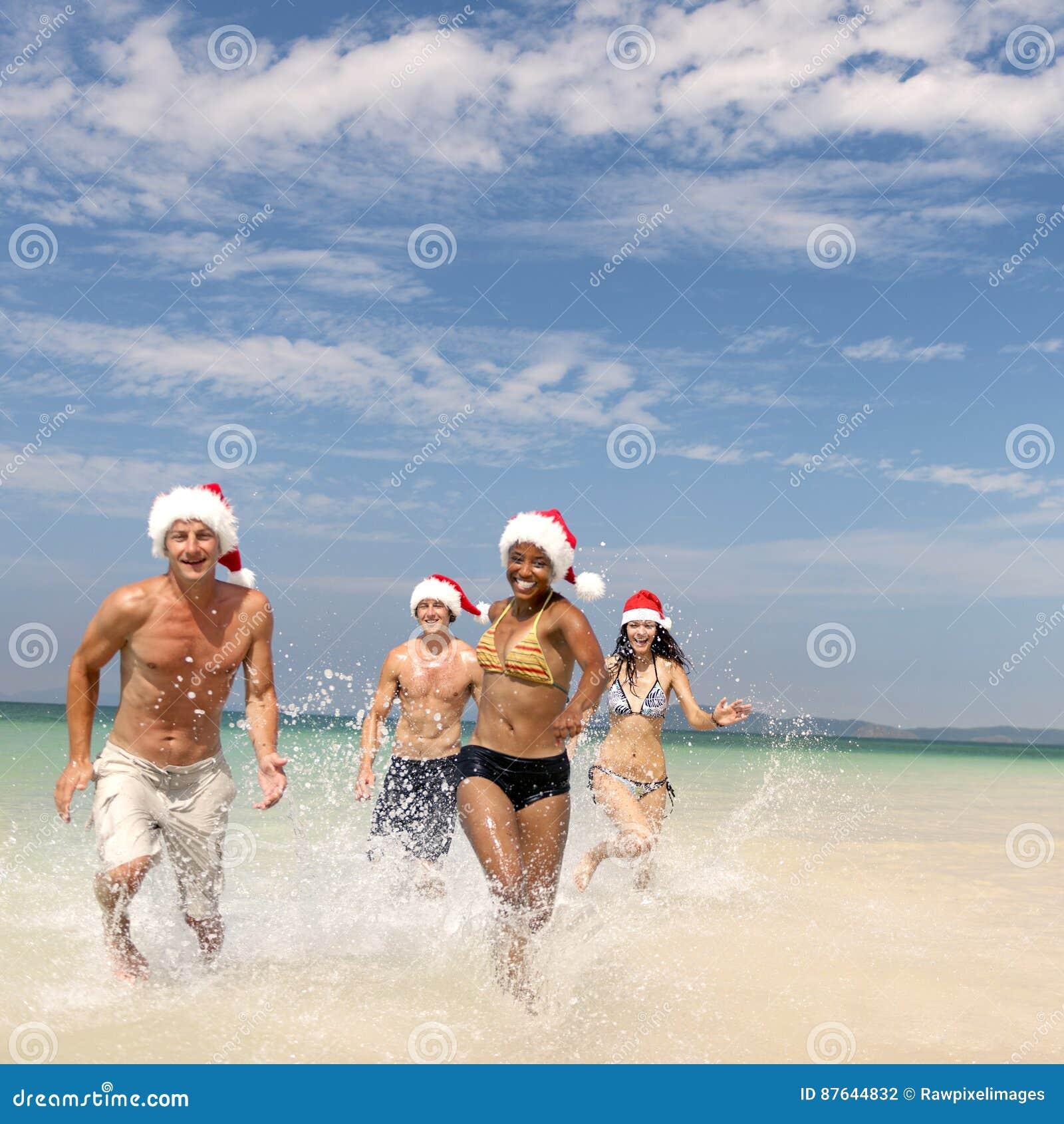 Concepto de Santa Hat Vacation Travel Beach de la Navidad