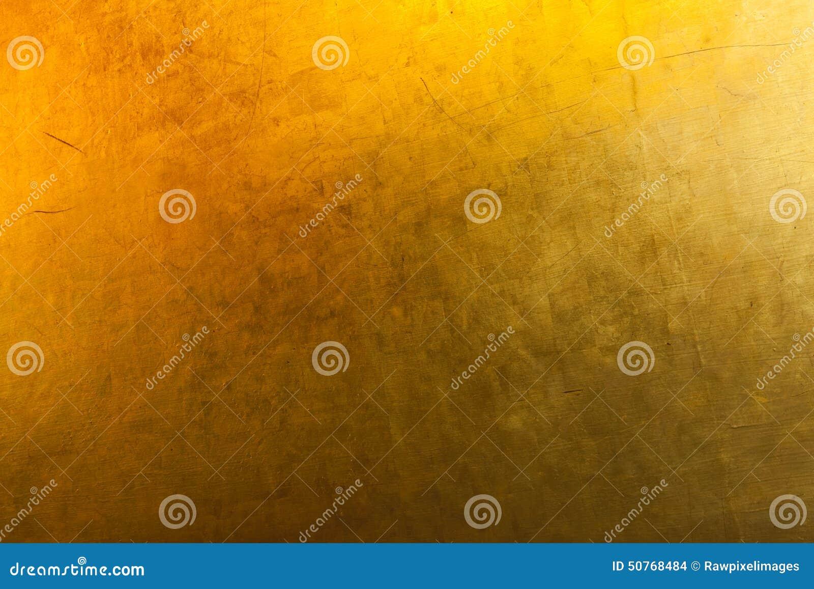 Concepto del fondo del papel pintado de la textura del oro