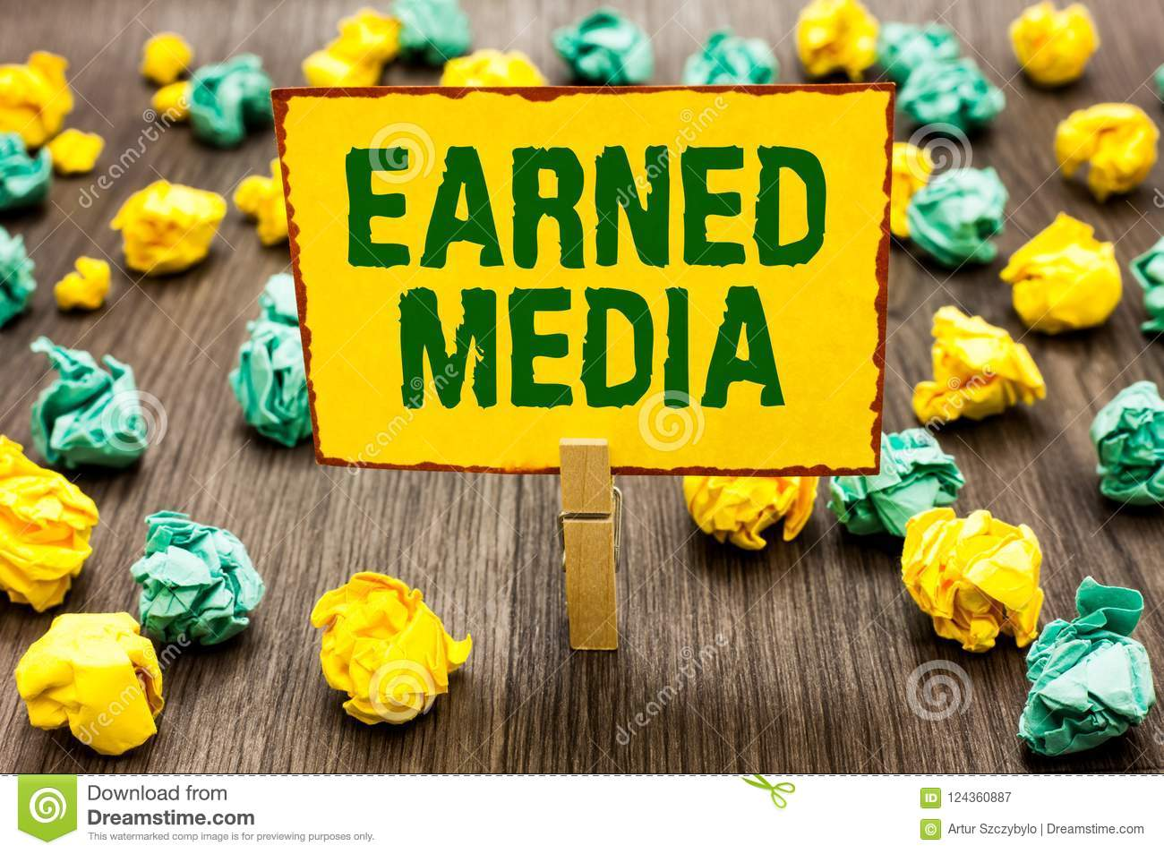 Conceptual hand writing showing Earned Media. Business photo text Publicity gained through promotional efforts by multimedia Cloth