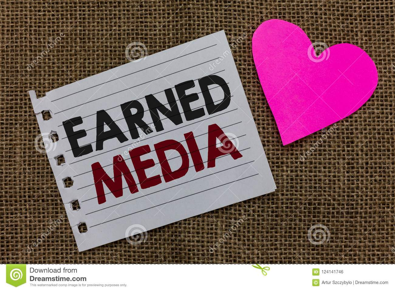 Conceptual hand writing showing Earned Media. Business photo text Publicity gained through promotional efforts by multimedia Piece