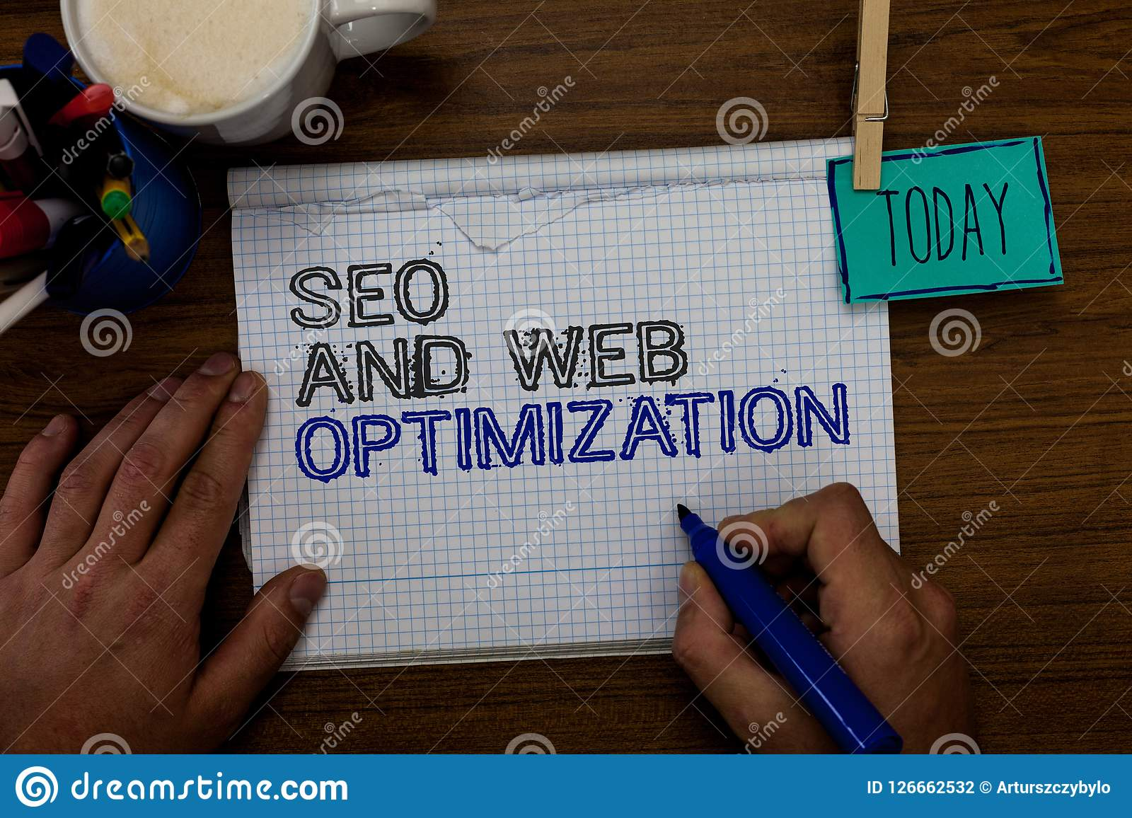 Conceptual hand writing showing Seo And Web Optimization. Business photo showcasing Search Engine Keywording Marketing Strategies. Hand hold pen paper clip Stock Photography