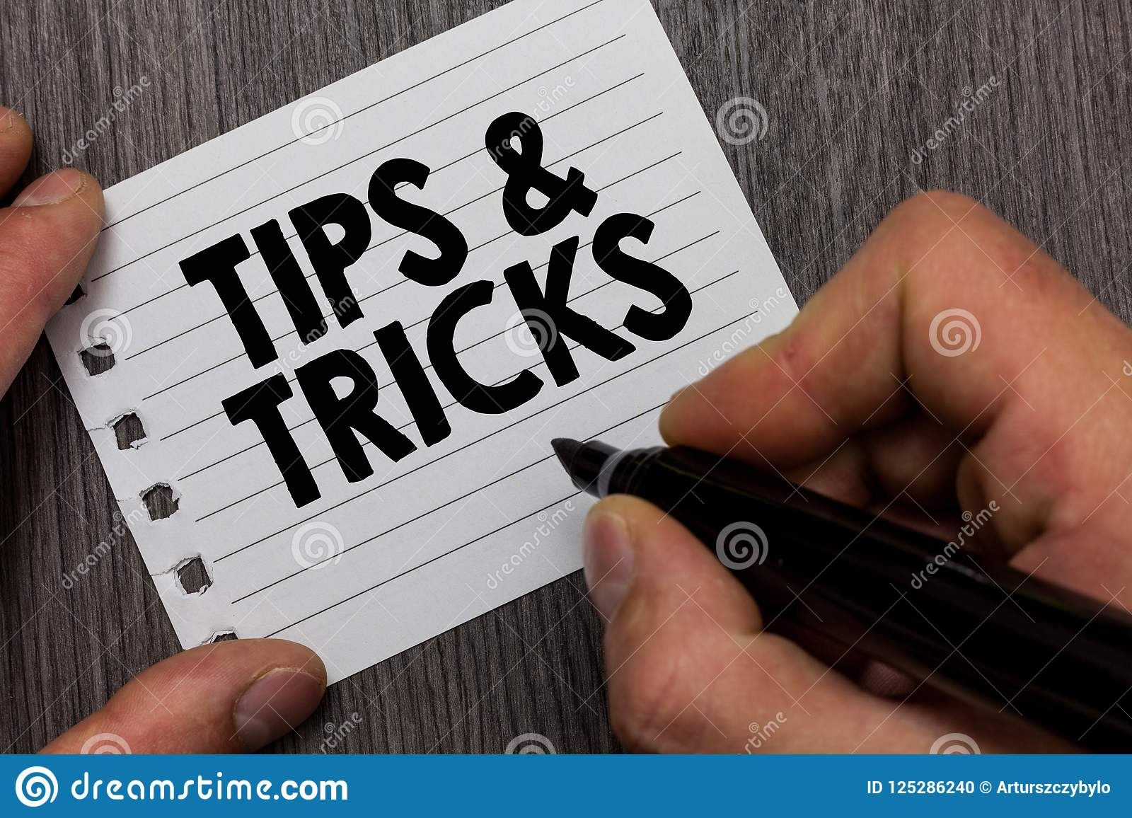 Conceptual hand writing showing Tips and Tricks. Business photo showcasing Steps Lifehacks Handy advice Recommendations Skills Man