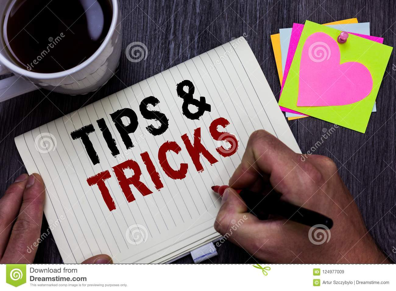 Conceptual hand writing showing Tips and Tricks. Business photo text Steps Lifehacks Handy advice Recommendations Skills Man holdi