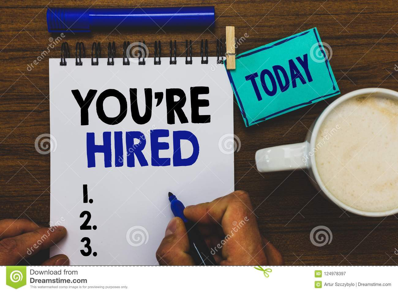 Conceptual hand writing showing You re are Hired. Business photo text New Job Employed Newbie Enlisted Accepted Recruited Man hold