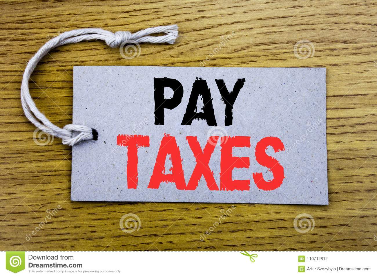 Conceptual hand writing text caption showing Pay Taxes. Business concept for Taxation Overtax Return written on price tag paper wi