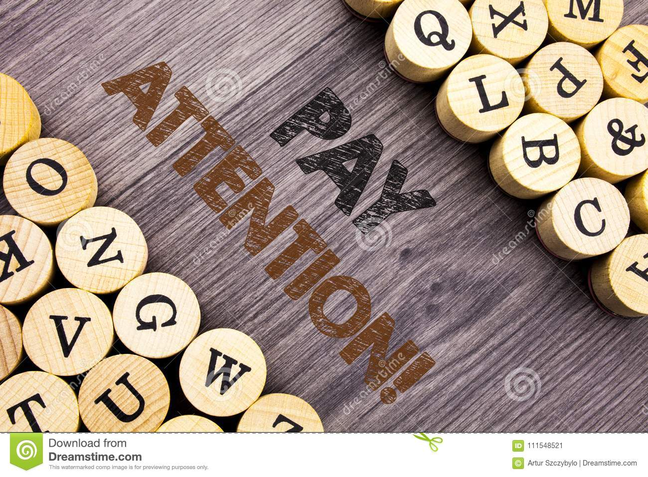 Conceptual hand writing text showing Pay Attention. Concept meaning Be Careful Beware Mindful Alarm written on wooden abckground w