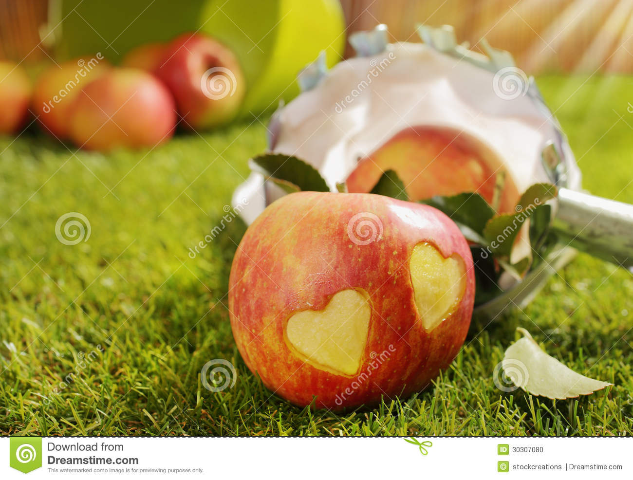 Red apple with a pair of incised hearts