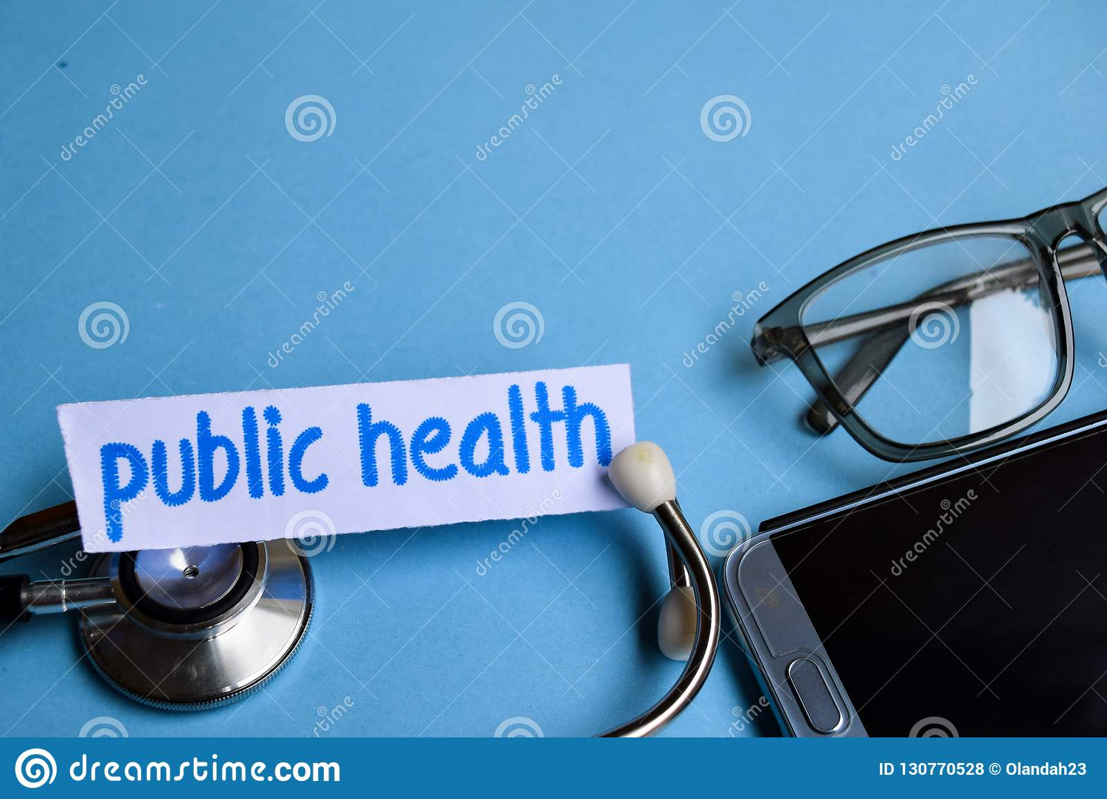 Public health inscription with the view of stethoscope, eyeglasses and smartphone on the blue background