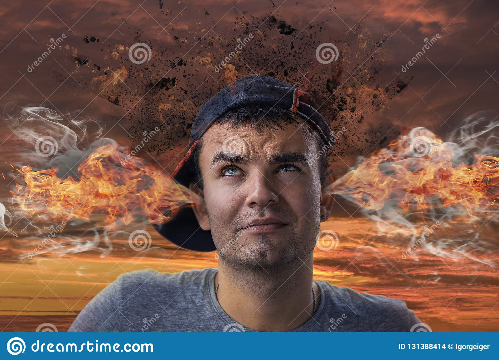 Conceptual image of a tense young man with smoke coming out of h