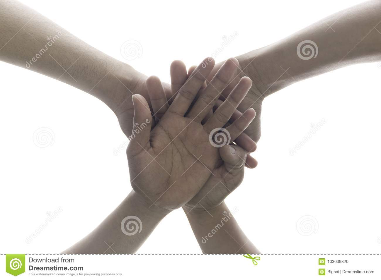 Conceptual people putting their hands working together as team w