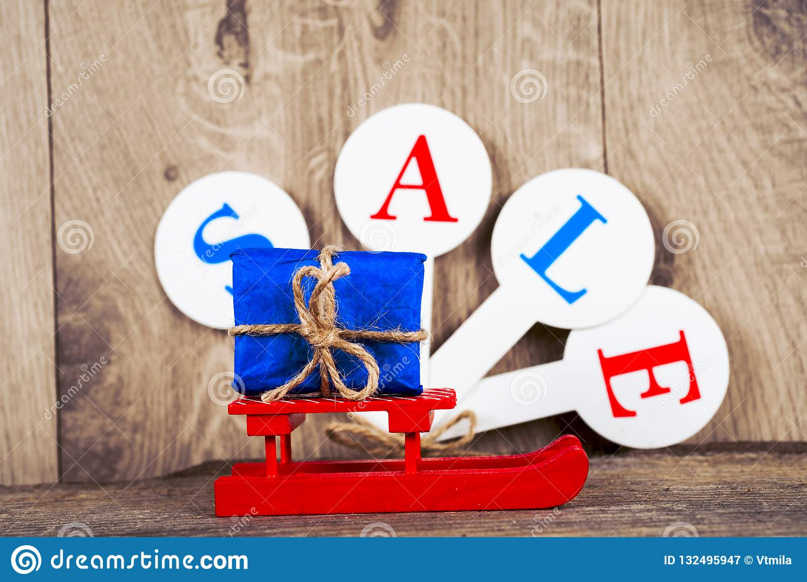 Conceptual photo of Christmas sales or gift shopping. The word SALE