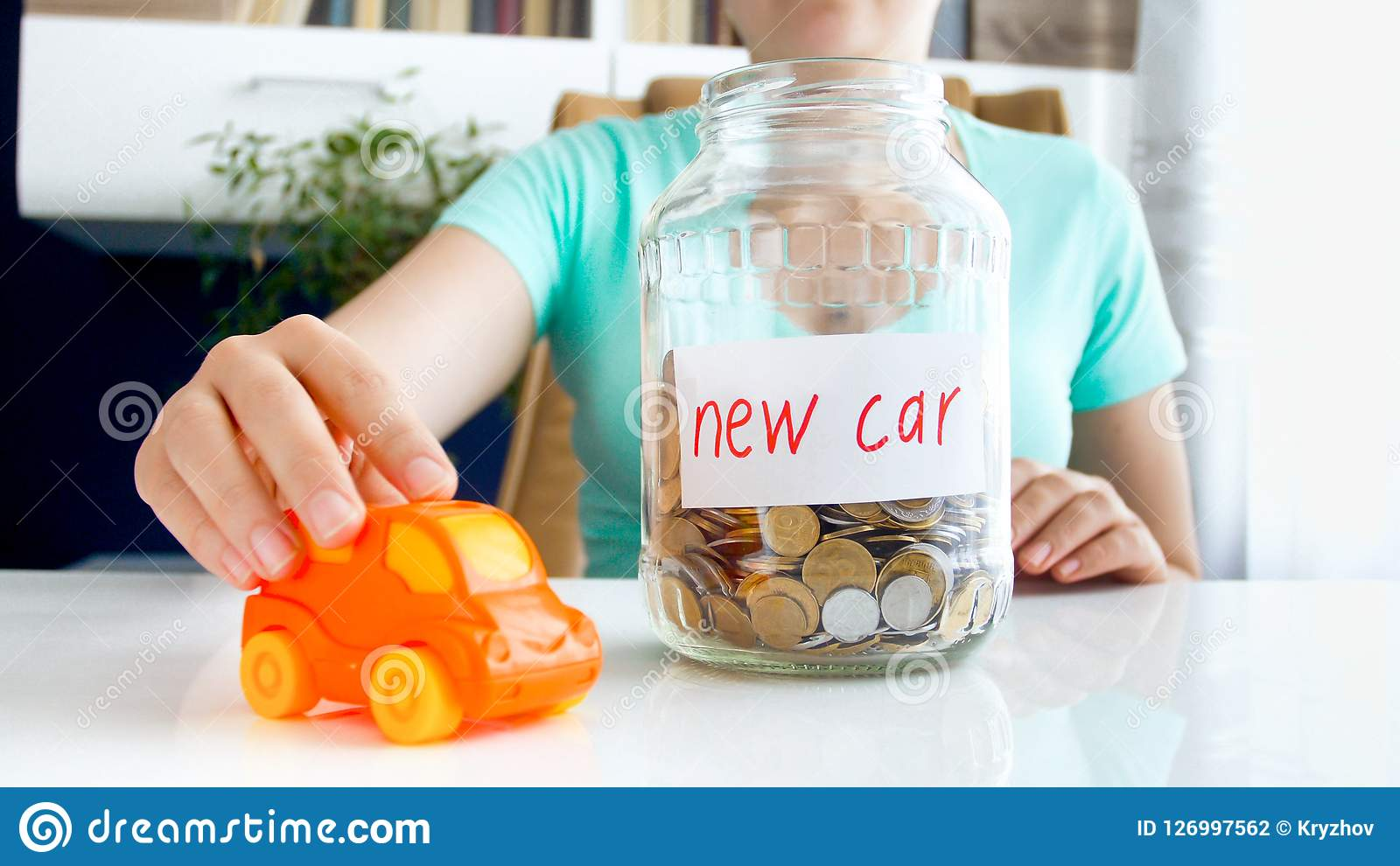 Conceptual image of saving money or taking bank loan for purchasing new car