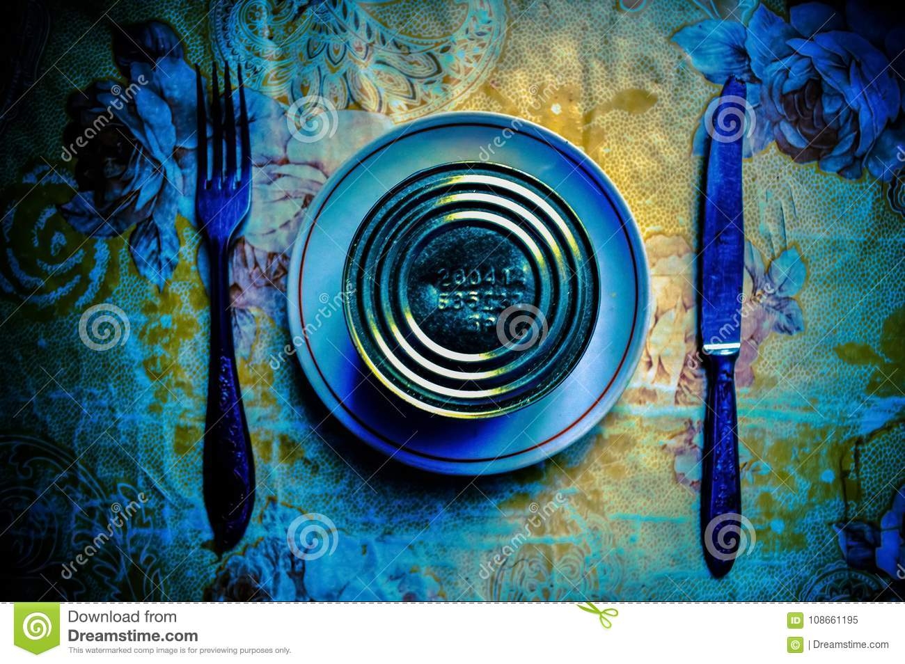 Conceptual serving of breakfast from canned food, knife and forks.