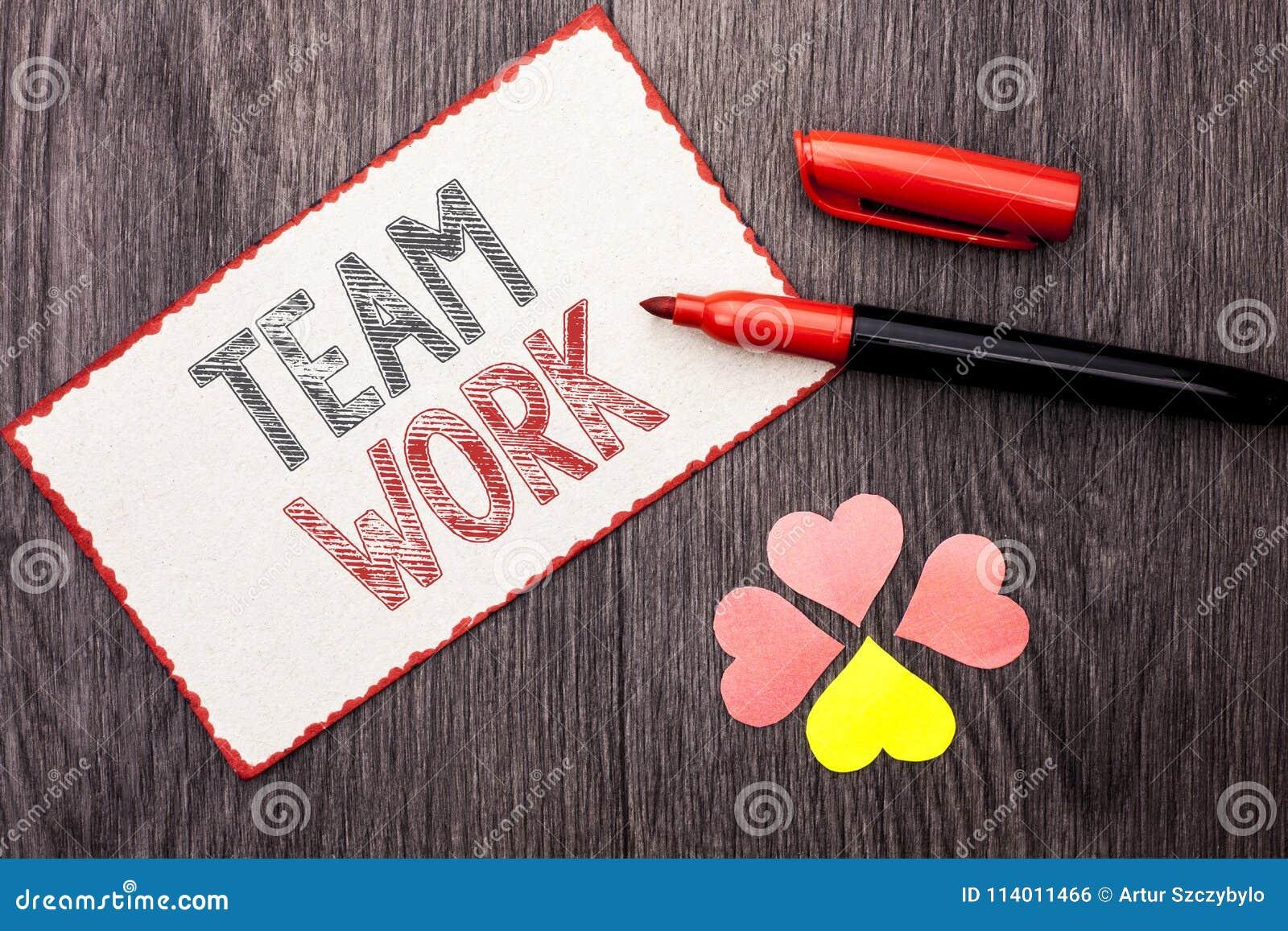 Conceptuele hand die tonend Team Work schrijven Van de de Samenwerkings samen Groep van de bedrijfsfototekst van de het Werkvolto
