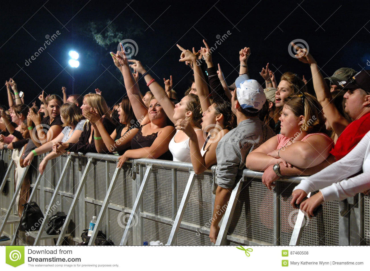 Fans taking pictures with cell phone behind barrier stock photo - Editorial Stock Photo Download Concert Crowd Cheering Behind Barrier