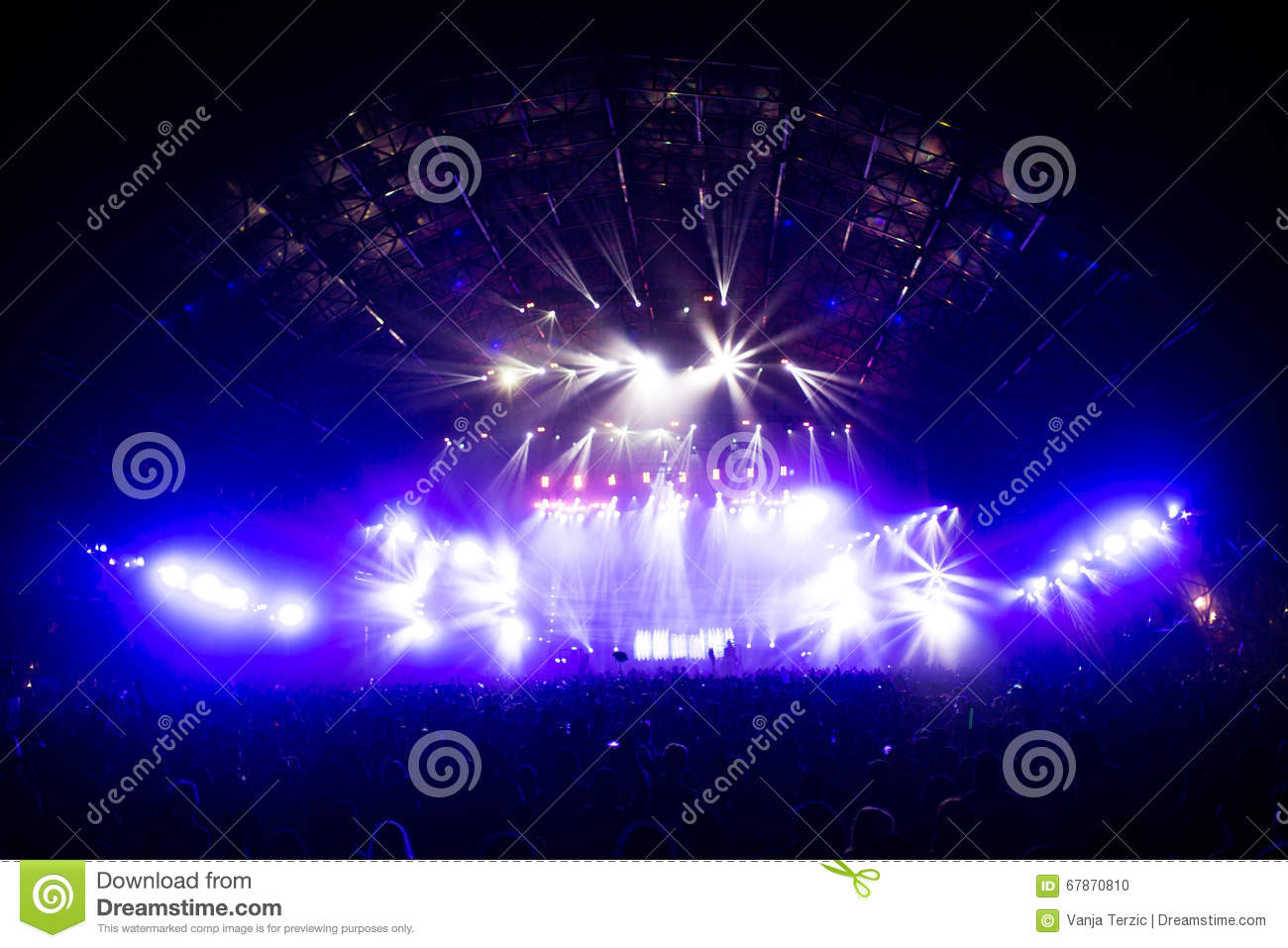 Concert Crowd In Front Of LED Stage Lighting Effects Stock Photo