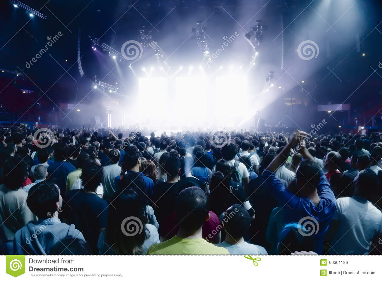 Concert crowd of people in front of bright stage lights