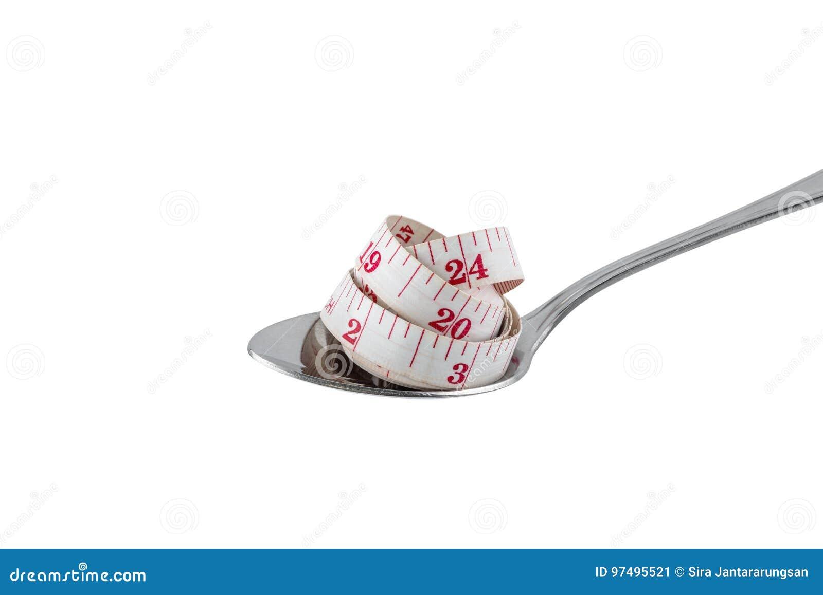 Concetto di dieta, cucchiaio d acciaio e nastro di misurazione isolati