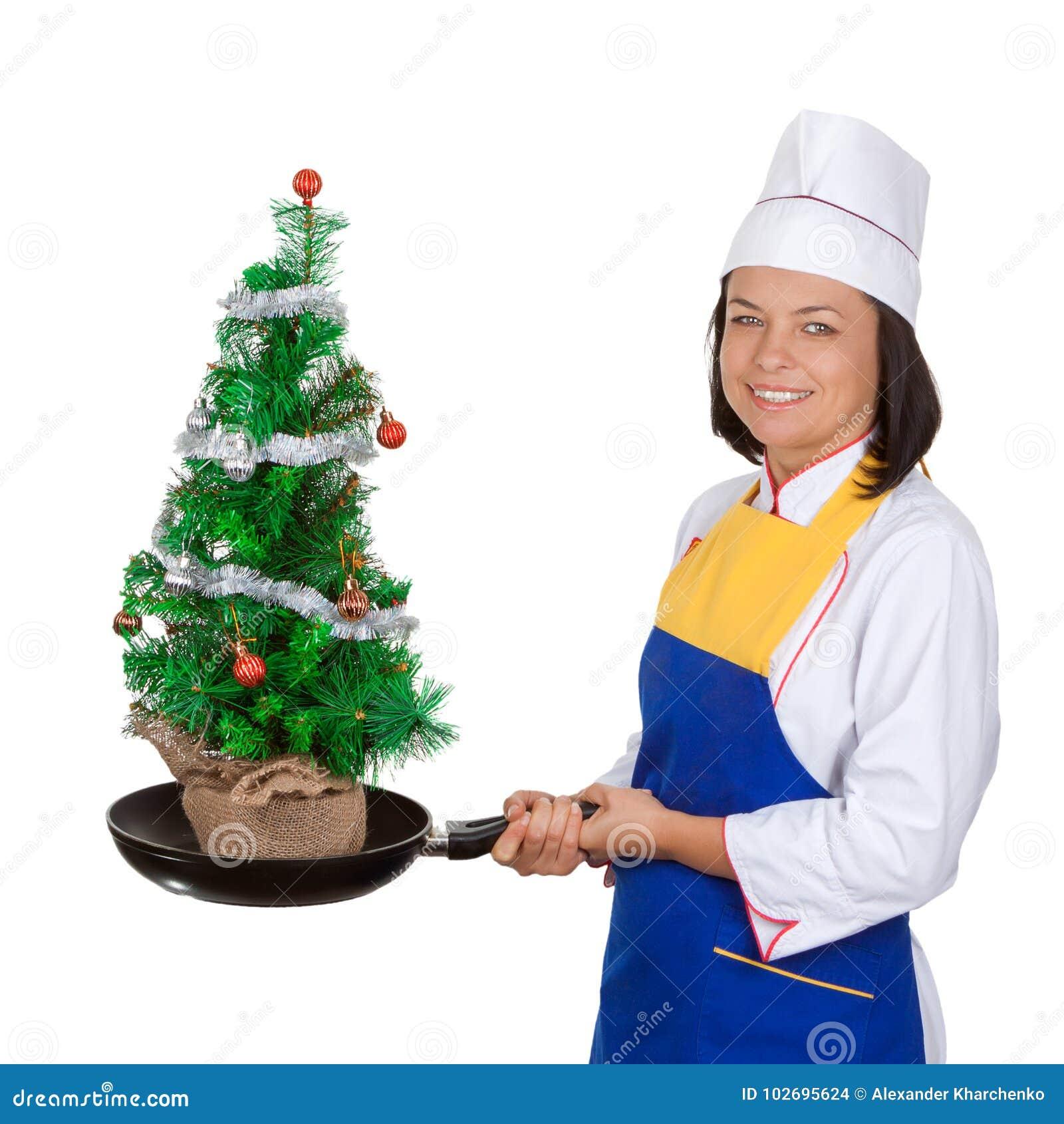 Concetto di Natale Bello cuoco unico della giovane donna con Chr decorato