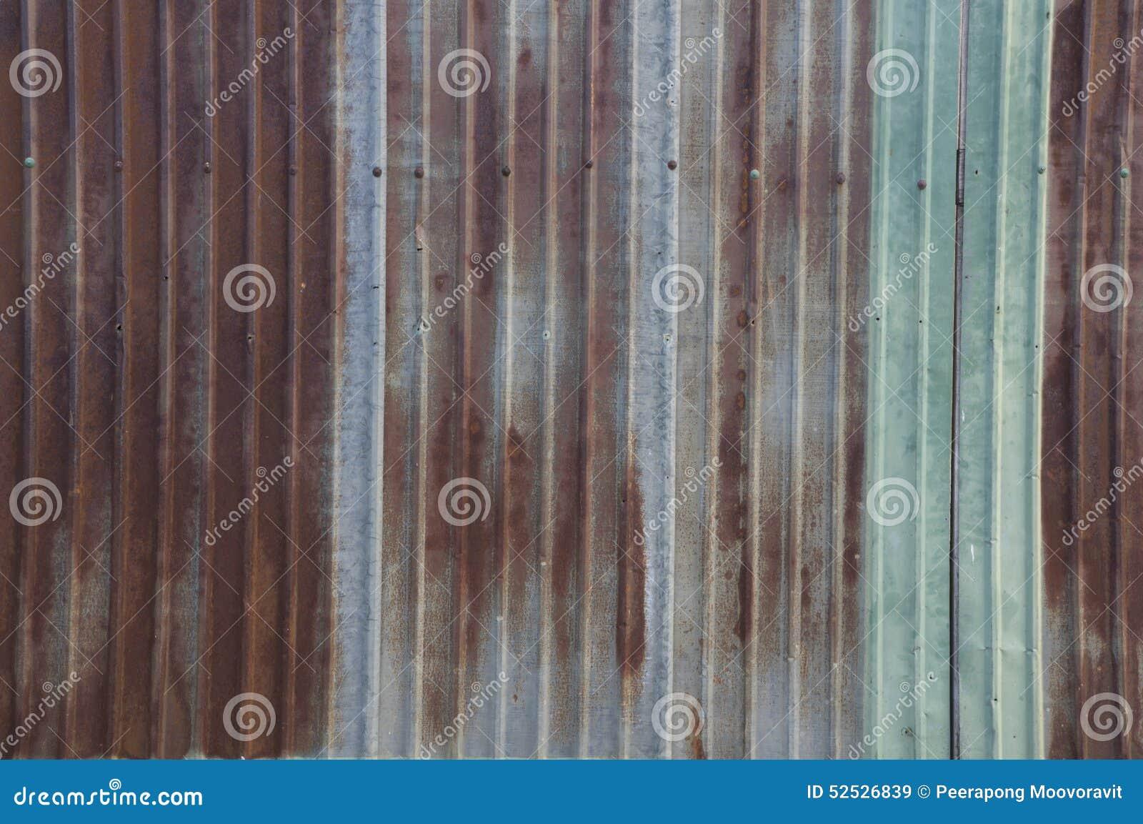 Concetto rustico della casa della casa della parete della ruggine della lamina di metallo