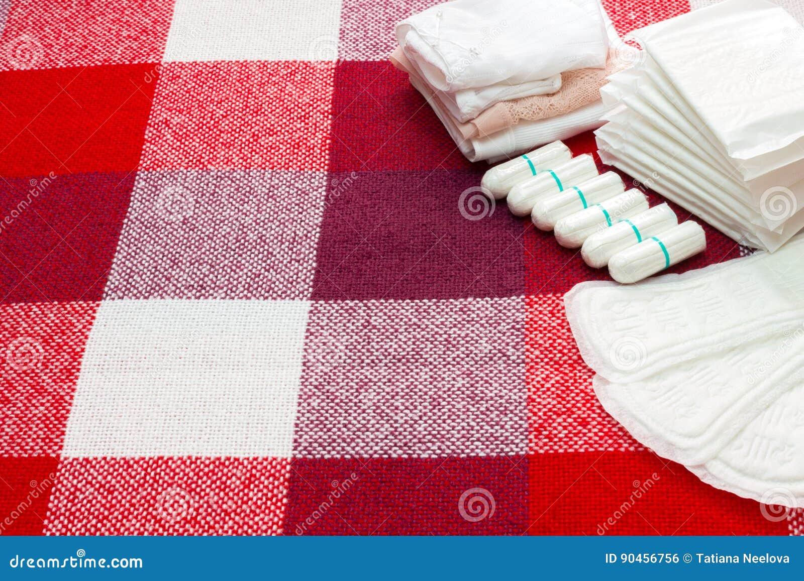 Concezione medica Tamponi del cuscinetto sanitario e del cotone di mestruazione per protezione di igiene della donna Protezione t