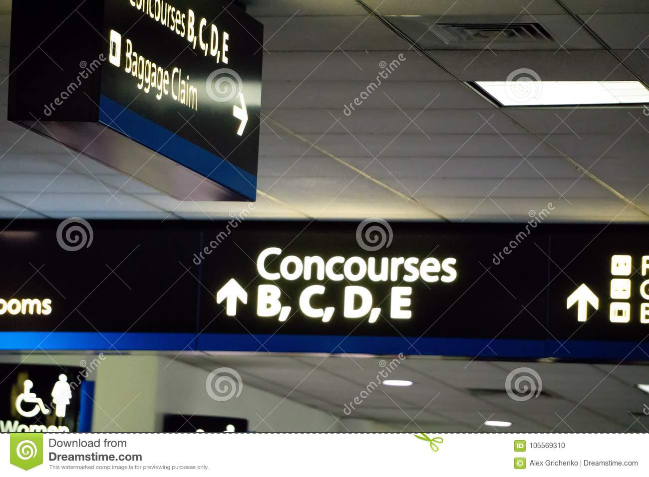 Concourse Sign And Directional Arrows At An Airport Stock Photo