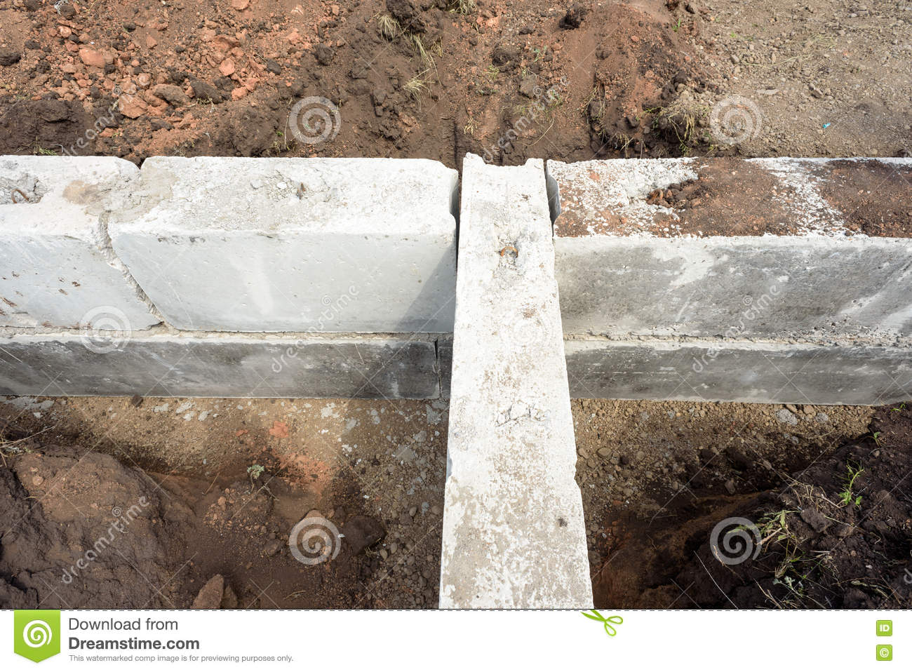 Concrete building block house foundations in earth stock for Cinder block house construction