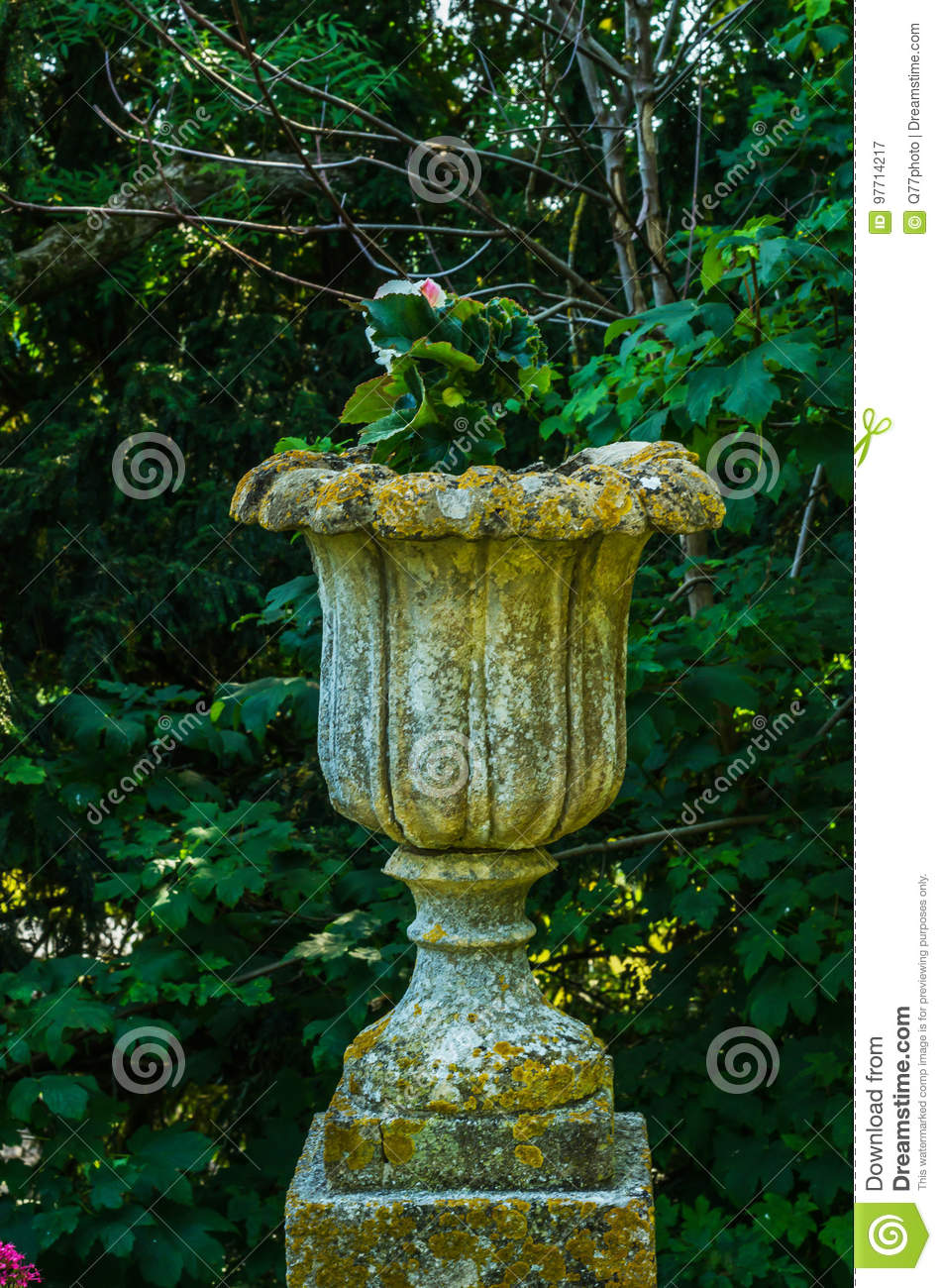 Dreamstime.com & Concrete Flower Pots In The Garden On A Pedestal Stylized Antique A ...