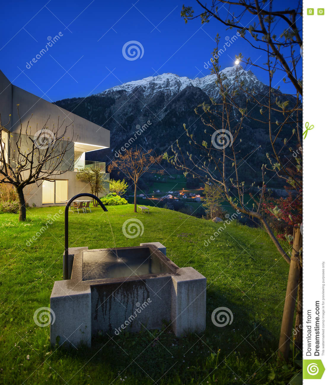 Concrete house with stone fountain